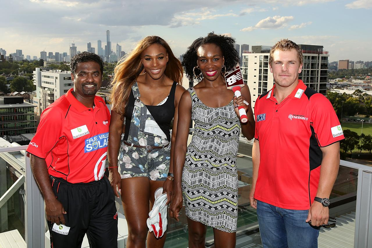 MELBOURNE, AUSTRALIA - JANUARY 09: Melbourne Renegades players Muthiah Muralidaran (L) and Aaron Finch (R) pose with Venus Williams and Serena Williams of the USA during a meet & greet with the Melbourne Renegades at The Olsen on January 9, 2014 in Melbourne, Australia. (Photo by Graham Denholm/Getty Images)