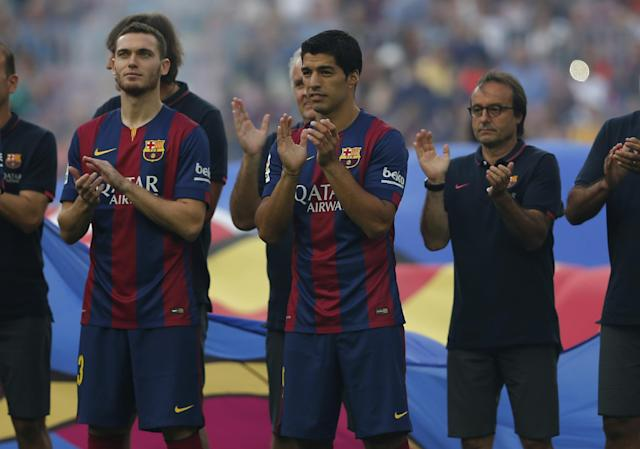 Barcelona's Luis Suarez, from Uruguay, centre, reacts during the official presentation of the Barcelona F.C team for the season 2014-2015 ahead of the Joan Gamper trophy match at the Camp Nou in Barcelona, Spain, Monday, Aug. 18, 2014. (AP Photo/Emilio Morenatti)