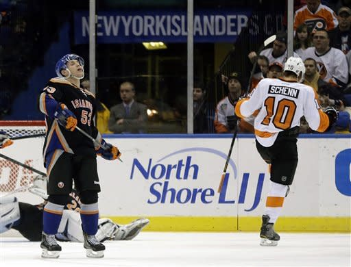 New York Islanders' Casey Cizikas, left, reacts after Philadelphia Flyers' Brayden Schenn scored during the second period of the NHL hockey game Monday, Feb. 18, 2013, in Uniondale, N.Y. (AP Photo/Seth Wenig)