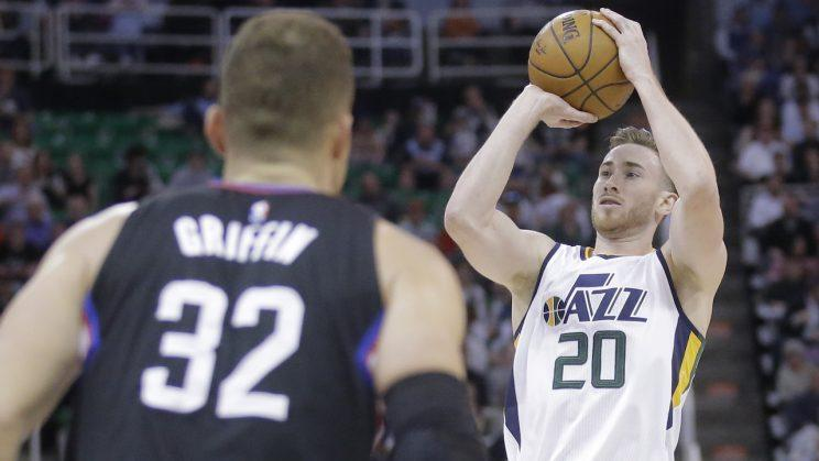 Blake Griffin prepares for Gordon Hayward to shoot his shot. (AP)