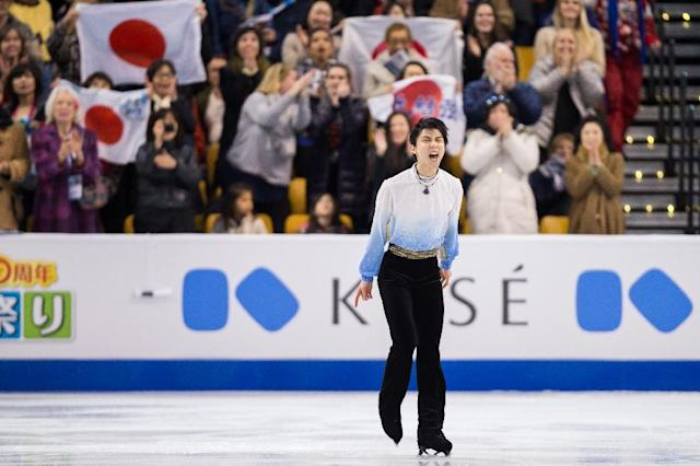 Yuzuru Hanyu of Japan, poised to regain his world title in Boston, pictured here as he completed his short program in the competition on March 30, 2016 (AFP Photo/Geoff Robins)