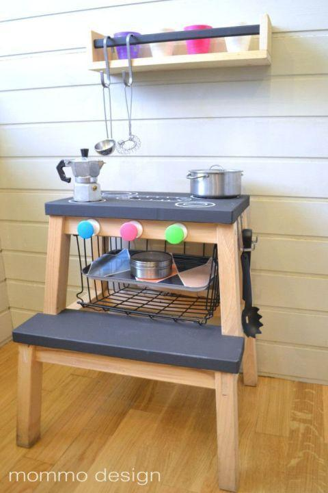 """<p>Your kids are going to love playing """"let's make dinner"""" alongside you—and you're going to love how affordable this set up is. It's as simple as painting the steps black, drawing on a stove top, and adding some knobs on the front to get the """"burners"""" going.</p><p>See more at <a href=""""http://www.mommodesign.com/black-and-white-ikea-hacks-kids.html"""" rel=""""nofollow noopener"""" target=""""_blank"""" data-ylk=""""slk:Mommo Design"""" class=""""link rapid-noclick-resp"""">Mommo Design</a>.</p><p><a class=""""link rapid-noclick-resp"""" href=""""https://www.amazon.com/Rust-Oleum-1913830-Chalkboard-Spray-11-Ounce/dp/B000RMPLJ6/?tag=syn-yahoo-20&ascsubtag=%5Bartid%7C2089.g.29514474%5Bsrc%7Cyahoo-us"""" rel=""""nofollow noopener"""" target=""""_blank"""" data-ylk=""""slk:BUY NOW"""">BUY NOW</a> <em><strong>Chalkboard Paint, $10, </strong></em><a href=""""https://www.amazon.com/Rust-Oleum-1913830-Chalkboard-Spray-11-Ounce/dp/B000RMPLJ6/?tag=syn-yahoo-20&ascsubtag=%5Bartid%7C2089.g.29514474%5Bsrc%7Cyahoo-us"""" rel=""""nofollow noopener"""" target=""""_blank"""" data-ylk=""""slk:amazon.com"""" class=""""link rapid-noclick-resp""""><em><span class=""""redactor-unlink"""">amazon.com</span></em></a></p>"""