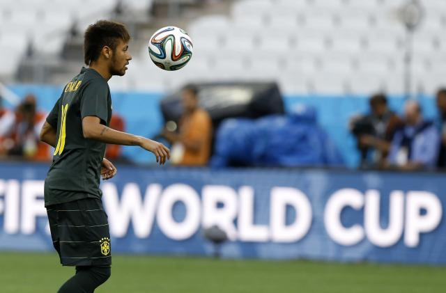 Brazil's Neymar plays with the ball during an official training session the day before the group A World Cup soccer match between Brazil and Croatia in the Itaquerao Stadium in Sao Paulo, Brazil, Wednesday, June 11, 2014. (AP Photo/Kirsty Wigglesworth)