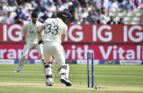 England's Mark Wood is bowled out by New Zealand's Matt Henry during the second day of the second cricket test match between England and New Zealand at Edgbaston in Birmingham, England, Friday, June 11, 2021. (AP Photo/Rui Vieira)