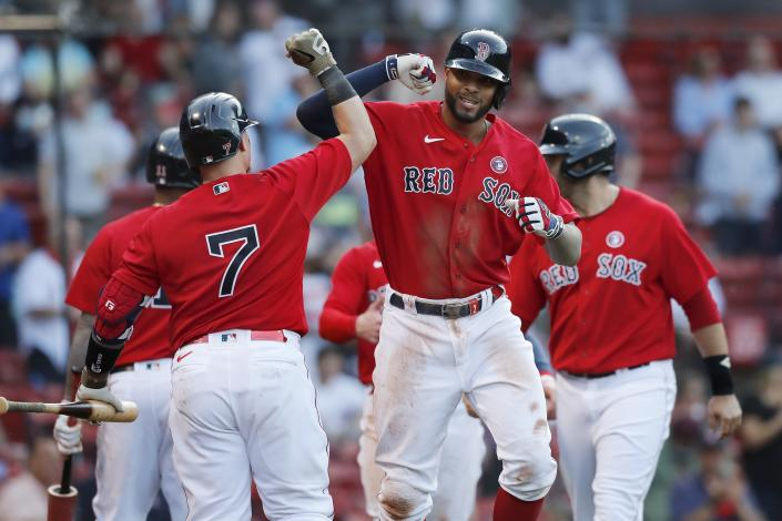 Boston Red Sox's Xander Bogaerts, front right, celebrates his three-run with Christian Vazquez (7) during the fifth inning of a baseball game against the Los Angeles Angels, Saturday, May 15, 2021, in Boston. (AP Photo/Michael Dwyer)