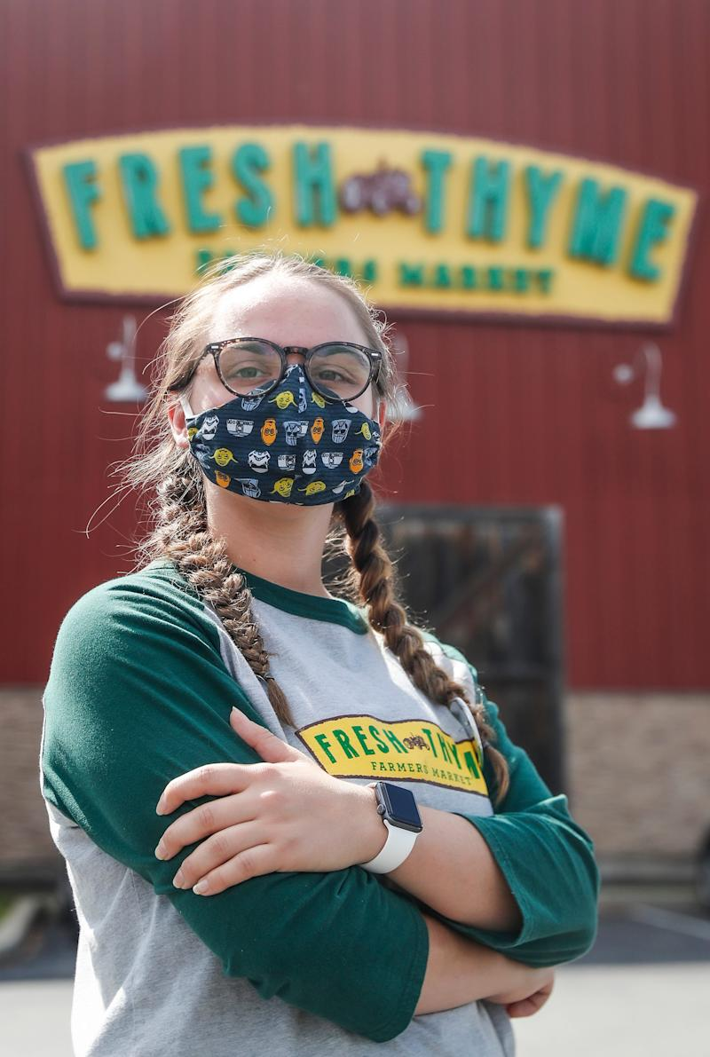 Four-month Fresh Thyme employee, Myra Carleton, poses for a photo outside of Fresh Thyme off of 86th St. in Indianapolis, Thursday, August 6, 2020.
