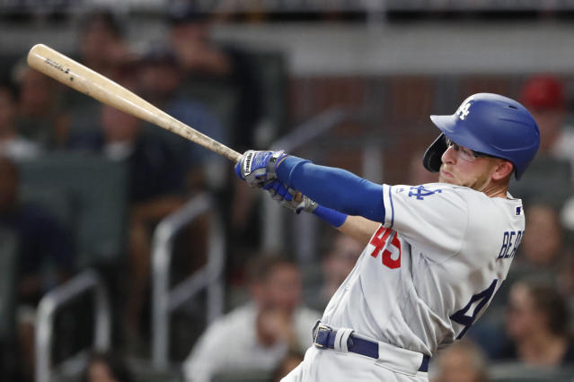 Los Angeles Dodgers' Matt Beaty drives in a run with a base hit in the fifth inning of a baseball game against the Atlanta Braves, Saturday, Aug. 17, 2019, in Atlanta. (AP Photo/John Bazemore)