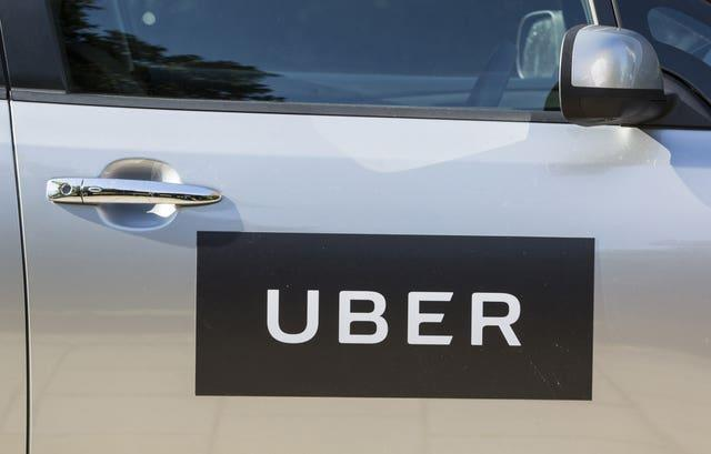 The logo of Uber on a car door (Laura Dale/AP)