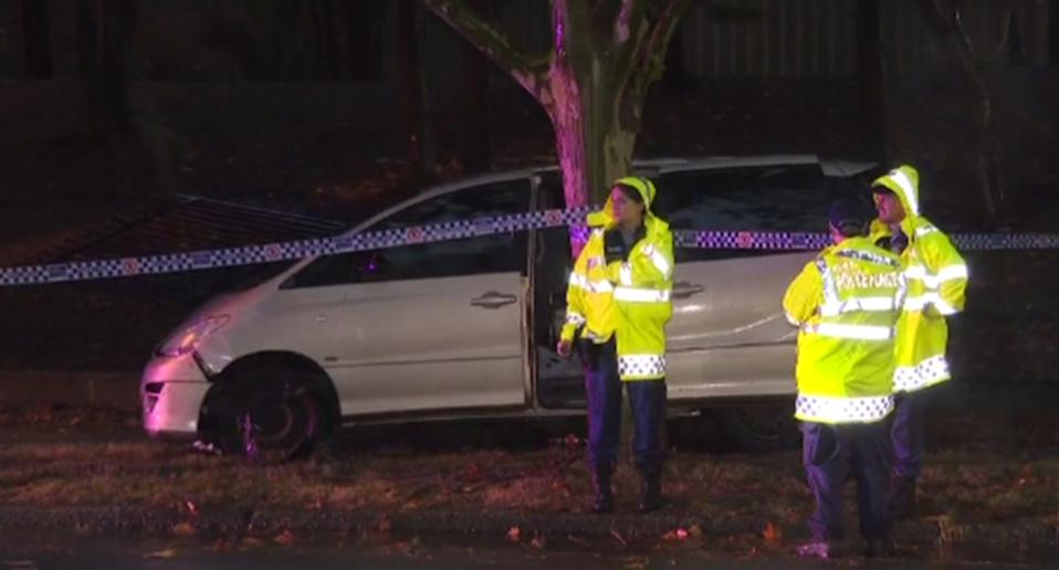 Police at the scene where a two-month-old baby was flung from a van after it crashed in Sydney