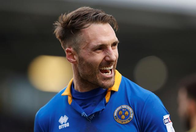 """Soccer Football - League One - Shrewsbury Town vs AFC Wimbledon - Montgomery Waters Meadow, Shrewsbury, Britain - March 24, 2018 Shrewsbury Town's Alex Rodman celebrates after the match Action Images/Ed Sykes EDITORIAL USE ONLY. No use with unauthorized audio, video, data, fixture lists, club/league logos or """"live"""" services. Online in-match use limited to 75 images, no video emulation. No use in betting, games or single club/league/player publications. Please contact your account representative for further details."""