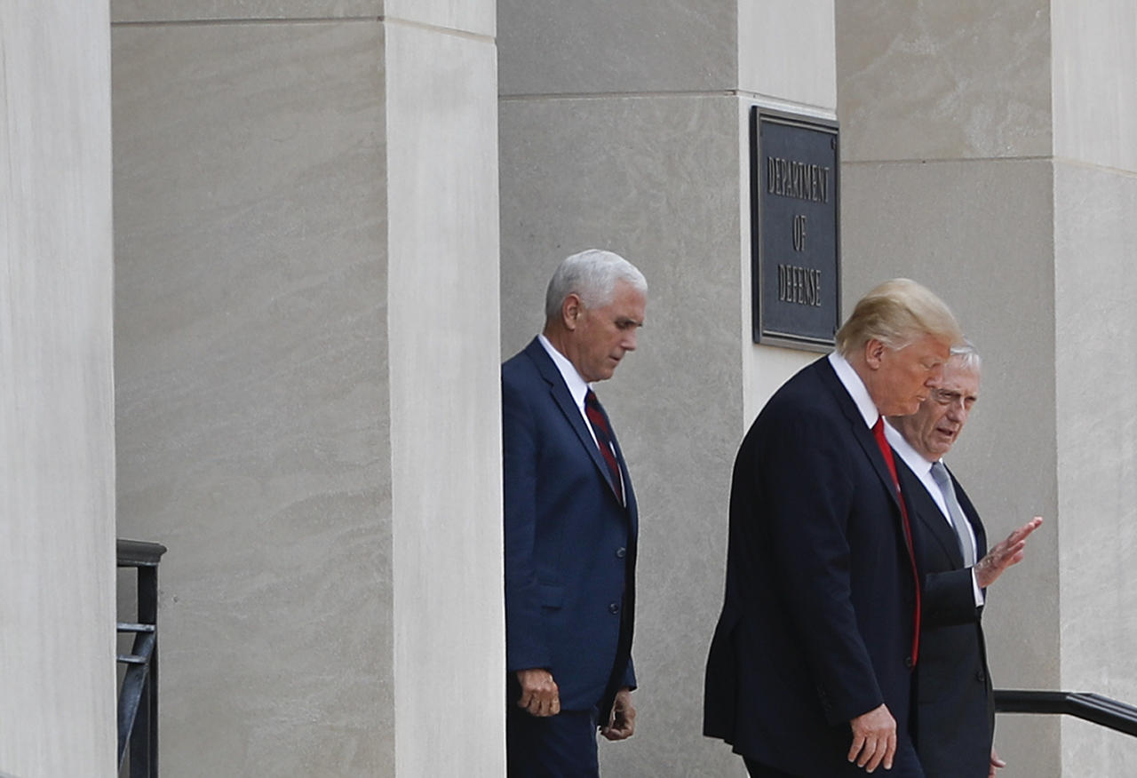 <p>Defense Secretary Jim Mattis, right, talks with President Donald Trump, center, followed by Vice President Mike Pence, left, after being briefed by members of Trump's national security team during a visit to the Pentagon, Thursday, July 20, 2017. (AP Photo/Pablo Martinez Monsivais) </p>