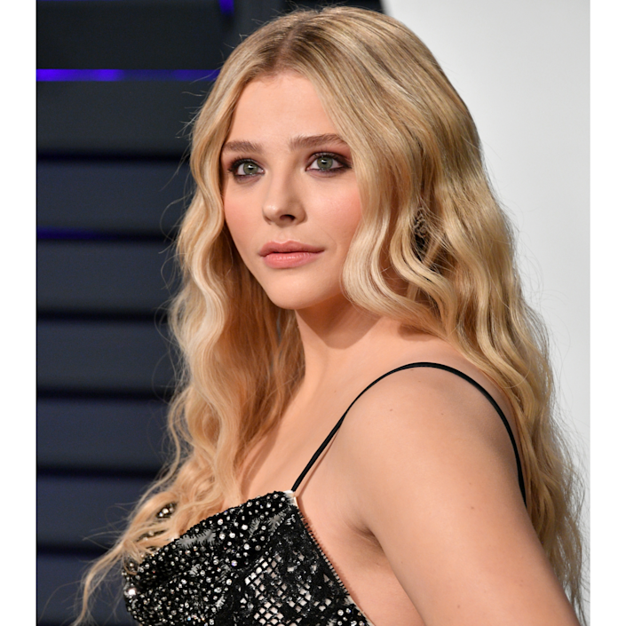 """See those little bits around Chloë Grace Moretz's face that are a luminous, moonlit tone? We're going to call that ivory, a version of platinum blonde that still has a yellowy brightness and isn't one bit bronze. The tone works best in wide ribbons of highlight against a cooler base; that way, it shows up even better. (Not unlike a moon against a night sky.) Want to steal her look? Us, too. """"Chloe's dimensions are made with combinations of gold irridescents, enhanced by warm gold tones with a hint of cooler-toned platinum blonde,"""" explains Ikeda."""