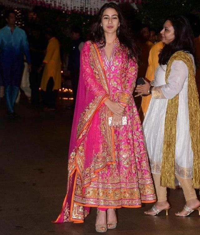 <p>In an exuberant pink and orange anarkali outfit by Abu Jani-Sandeep Khosla, the actress-to-be, beams in youthful glow. This picture was clicked during Ambani's Ganesh Chaturthi last year, but Sara, in this ethnic ensemble, is all the illumine nights of the Navratri put together. </p>