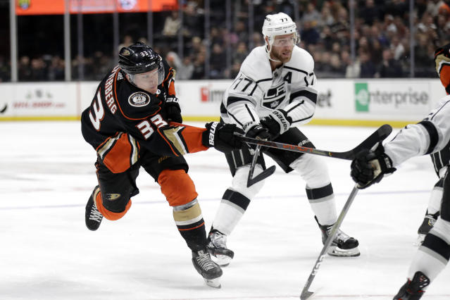 Anaheim Ducks' Jakob Silfverberg (33) shoots past Los Angeles Kings' Jeff Carter (77) during the second period of an NHL hockey game, Monday, Dec. 2, 2019, in Anaheim, Calif. (AP Photo/Marcio Jose Sanchez)