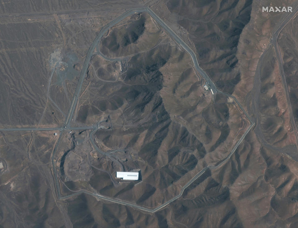 This Nov. 1, 2019, satellite image provided by provided by Maxar Technologies shows the Fordo nuclear facility, just north of the holy city of Qom in Iran. The resumption of activity at Fordo pushes the risk of a wider confrontation involving Iran even higher after months of attacks across the Middle East that the U.S. blames on Tehran. (Satellite image ©2019 Maxar Technologies via AP)