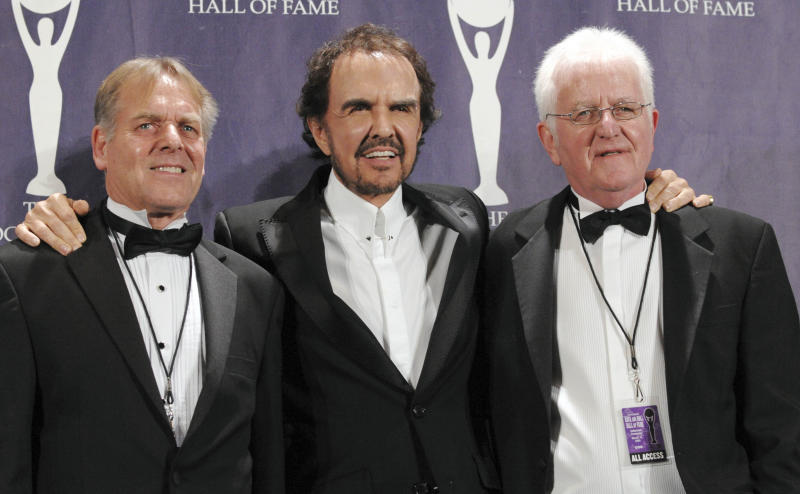 """FILE - In this March 10, 2008 file photo, musicians Dave Clark, center, Lenny Davidson, left, and Rick Huxley of the British band the Dave Clark Five pose backstage at the Rock and Roll Hall of Fame Induction Ceremony, in New York. There was more to the 1960s British invasion than the Beatles, as any fan of """"Catch Us If You Can"""" or """"Because"""" or - get ready to shimmy - """"Glad All Over."""" The hit tunes were among those recorded by the influential U.K. band that gets its due in """"The Dave Clark Five and Beyond: Glad All Over,"""" a PBS documentary airing Tuesday, April 8, 2014 (check local listings). (AP Photo/Evan Agostini, file)"""