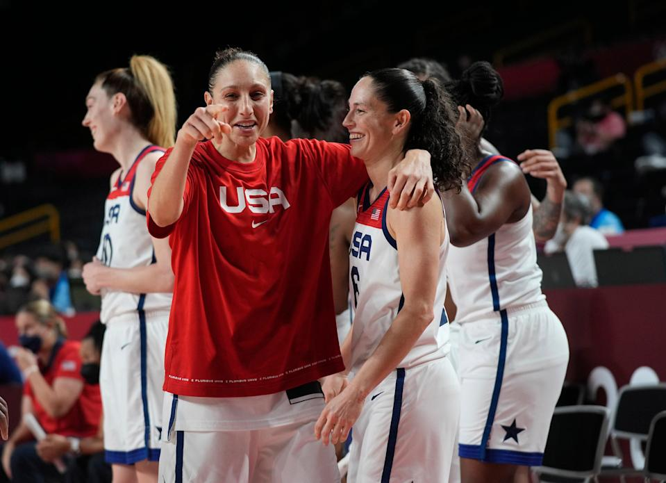 Diana Taurasi and Sue Bird celebrate after the U.S. women's basketball team won the gold medal.