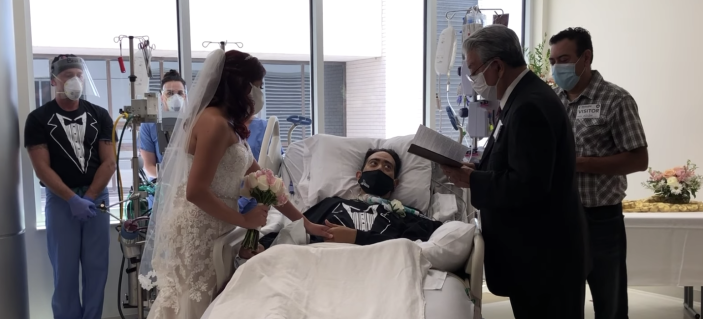 Groom Carlos Muniz and bride Grace Leimann exchange vows over Muniz's hospital bed while he fought coronavirus. (Photo: Methodist Hospital)