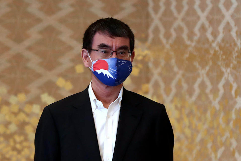 Japan's Defense Minister Taro Kono, wearing a face mask to to help curb the spread of the new coronavirus, waits for U.S. Deputy Secretary of State Stephen Biegun, the top U.S. official on North Korea, to arrive for a bilateral meeting in Tokyo Friday, July 10, 2020. (Behrouz Mehri/Pool Photo via AP)
