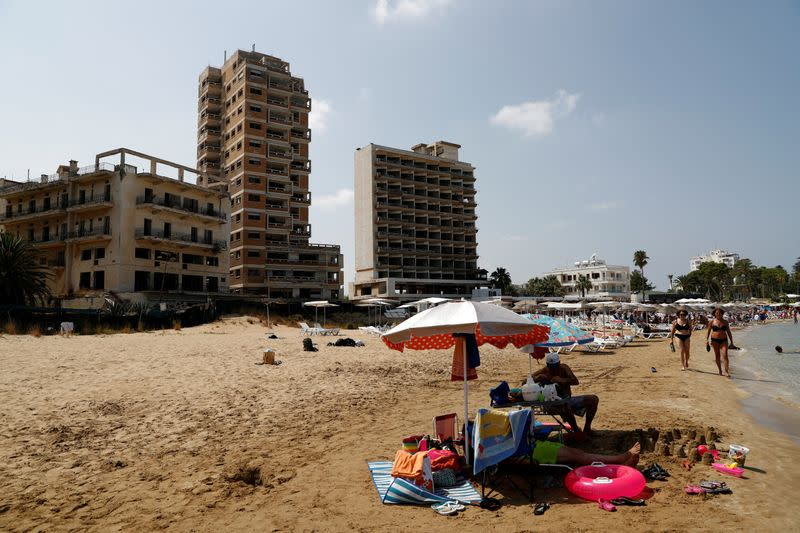 FILE PHOTO: Abandoned buildings in Varosha, an area fenced off by the Turkish military since the 1974 division of Cyprus, are seen from a beach in Famagusta