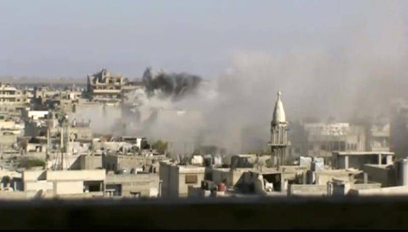 This image made from amateur video released by Shaam News Network and accessed Friday, June 8, 2012, purports to show explosions in the Khaldiyeh area of Homs, Syria. Syrian troops on Friday heavily shelled a rebel-held neighborhood in the flashpoint central city of Homs as President Bashar Assad's troops appeared to be readying to storm the area that has been out of government control for months and it was not clear if U.N. observers were able to enter an area where a massacre occurred this week, activists said. (AP Photo/Shaam News Network via AP video)THE ASSOCIATED PRESS CANNOT INDEPENDENTLY VERIFY THE CONTENT, DATE, LOCATION OR AUTHENTICITY OF THIS MATERIAL