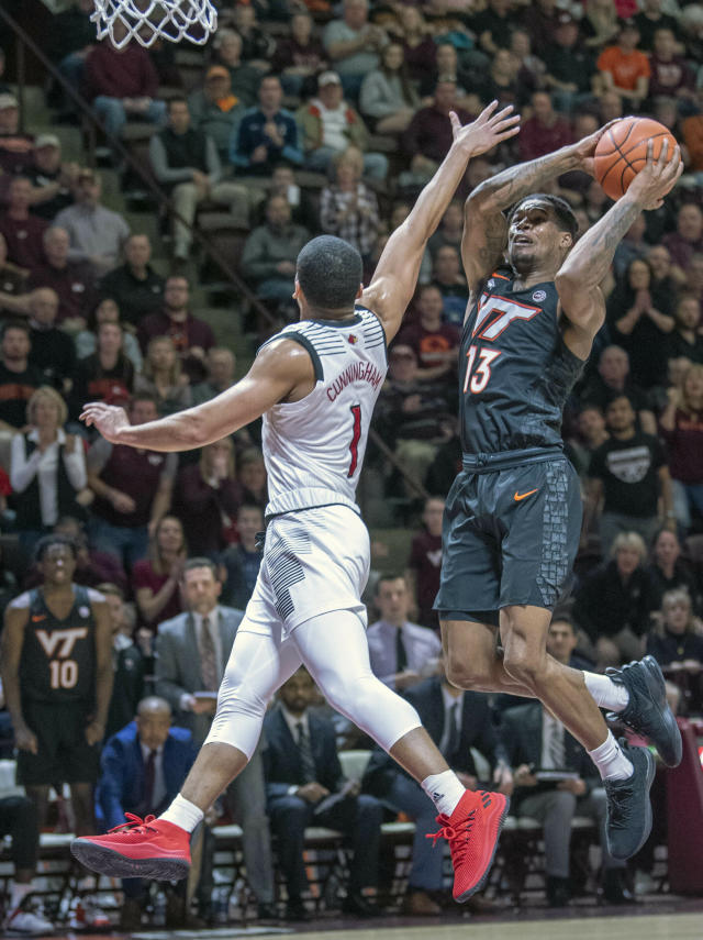 Virginia Tech Hokies guard Ahmed Hill (13) shoots the ball on a fast break against Louisville guard Christen Cunningham (1) during the second half of an NCAA college basketball game Monday, Feb. 4, 2019, in Blacksburg, Va. (AP Photo/Don Petersen)