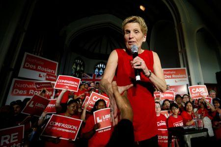 Ontario Liberal leader and Premier Kathleen Wynne shakes hands with a supporter during a campaign rally in Ottawa, Ontario, Canada, May 9, 2018. REUTERS/Chris Wattie