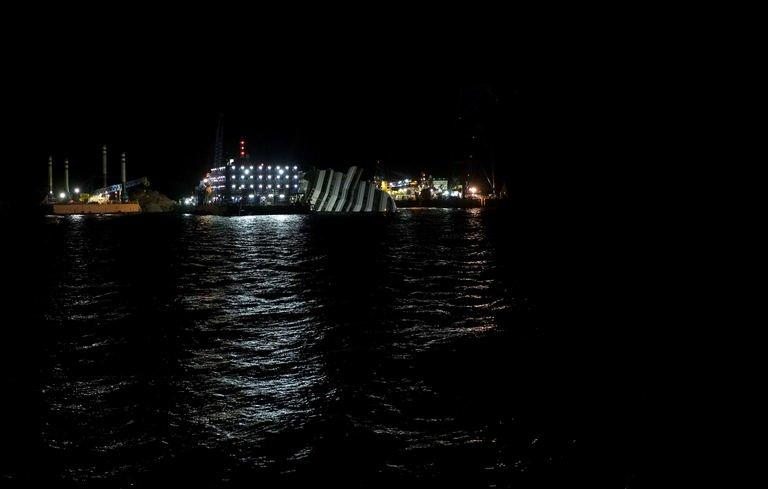 The Costa Concordia cruise ship lays aground on January 13, 2013 on the Italian island of Giglio. Boats sounded their horns off the Italian island of Giglio on Sunday in memory of the exact moment a year ago when the Costa Concordia cruise ship crashed in a tragedy that claimed 32 lives