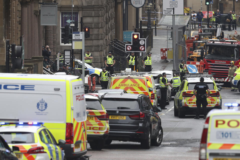 Emergency services attend the scene of an incident in Glasgow, Scotland, Friday June 26, 2020. Police in Glasgow say emergency services are currently dealing with an incident in the center of Scotland's largest city and are urging people to avoid the area. (Andrew Milligan/PA via AP)