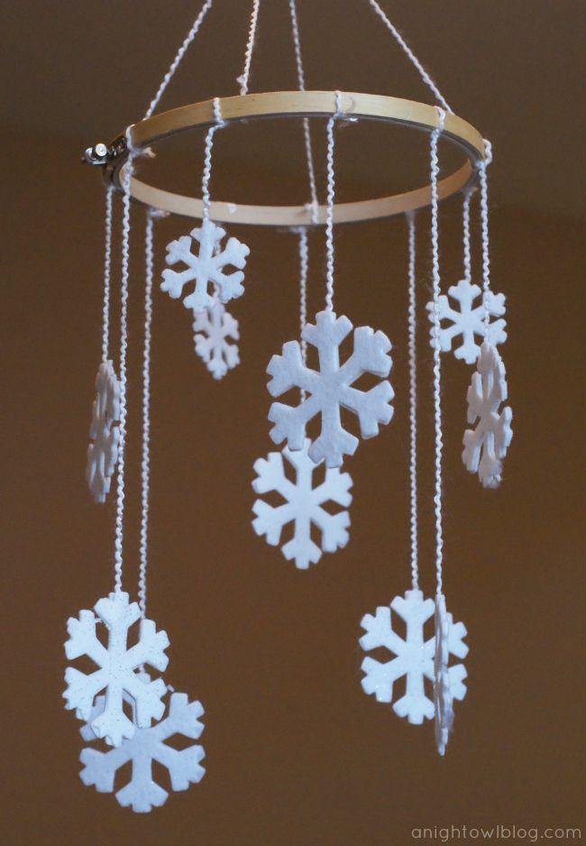 """<p>Attach felt snowflakes to an embroidery hoop using yarn for a whimsical winter mobile, in chic and seasonal white.</p><p><em><a href=""""https://www.anightowlblog.com/diy-snowflake-mobile/"""" rel=""""nofollow noopener"""" target=""""_blank"""" data-ylk=""""slk:Get the tutorial at A Night Owl Blog"""" class=""""link rapid-noclick-resp"""">Get the tutorial at A Night Owl Blog</a></em></p>"""