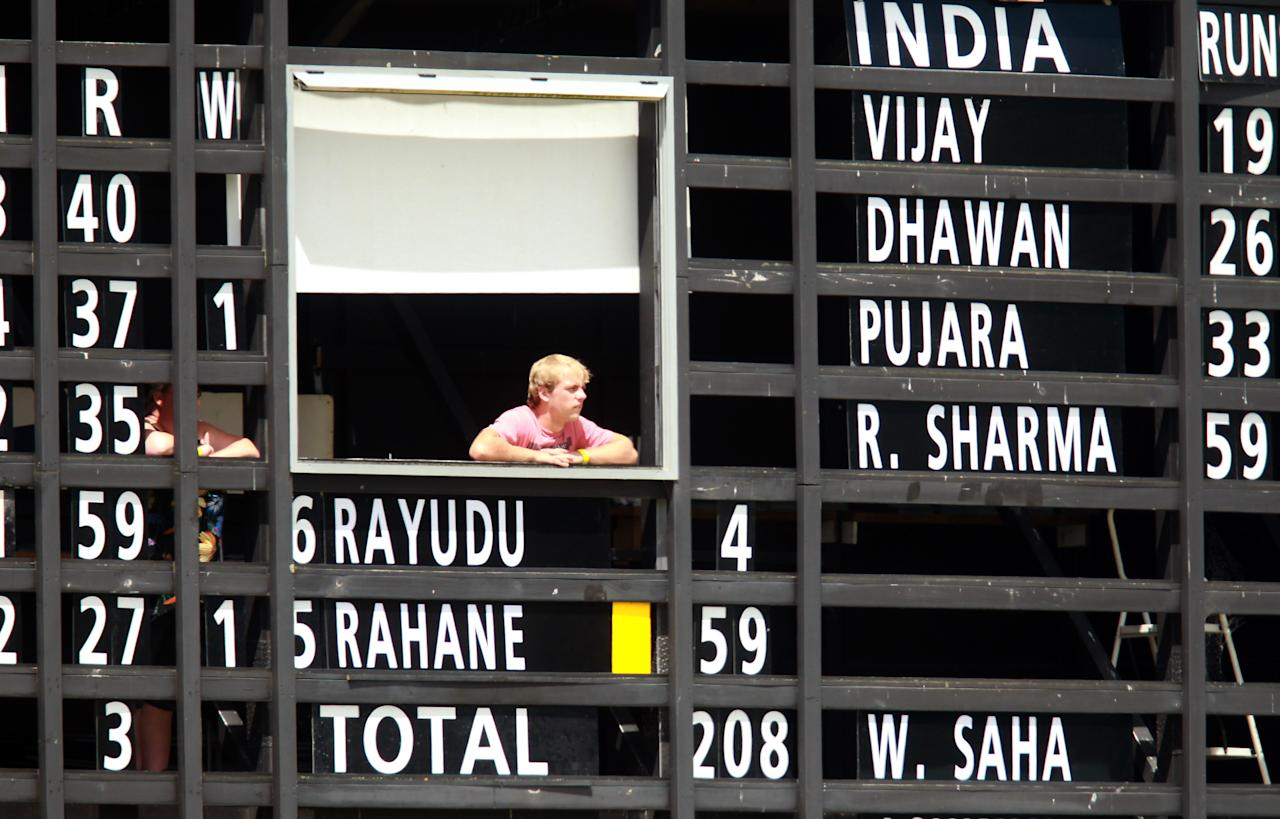 WHANGAREI, NEW ZEALAND - FEBRUARY 03:  The scoreboard attentant keeps a close eye on the action during day two of the international tour match between the New Zealand XI and India at Cobham Oval on February 3, 2014 in Whangarei, New Zealand.  (Photo by Jason Oxenham/Getty Images)