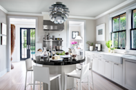 "<p>The all-white scheme becomes a smooth backdrop for dramatic works of art like the eight-foot antique African drum in the corner of this Hamptons kitchen. Homeowners Quinn Pofahl and Jaime Jiménez renovated the first-floor layout to allow all public spaces to be seen from the kitchen. The hood and stove are from <a href=""http://www.vikingrange.com/consumer/index.jsp"" rel=""nofollow noopener"" target=""_blank"" data-ylk=""slk:Viking"" class=""link rapid-noclick-resp"">Viking</a>. The walls are in Benjamin Moore's Ice Formations.<br><br><a class=""link rapid-noclick-resp"" href=""https://www.benjaminmoore.com/en-us/color-overview/find-your-color/color/973/ice-formations?color=973"" rel=""nofollow noopener"" target=""_blank"" data-ylk=""slk:Get the Look"">Get the Look</a></p>"