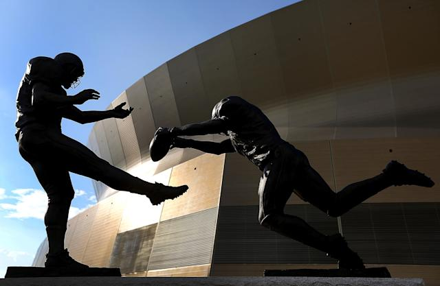 "Steve Gleason's punt block against the Falcons was immortalized in a statue titled ""Rebirth."" (Photo by Jonathan Bachman/Getty Images)"
