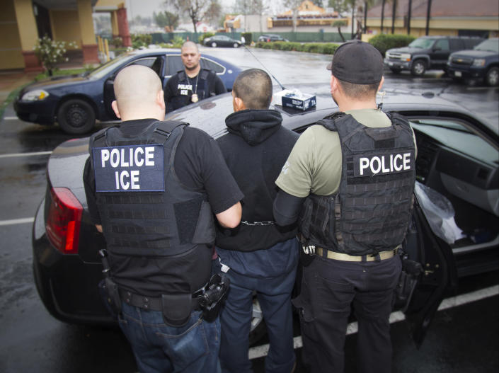 U.S. Immigration and Customs Enforcement agents conduct a raid in Southern California
