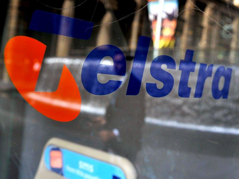 Telstra shares hit four year high