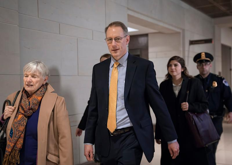 Mark Sandy, a career employee in the White House Office of Management and Budget, arrives at the Capitol to testify in the House Democrats' impeachment inquiry about President Donald Trump's effort to tie military aid for Ukraine to investigations of his political opponents, in Washington, Saturday, Nov. 16, 2019.