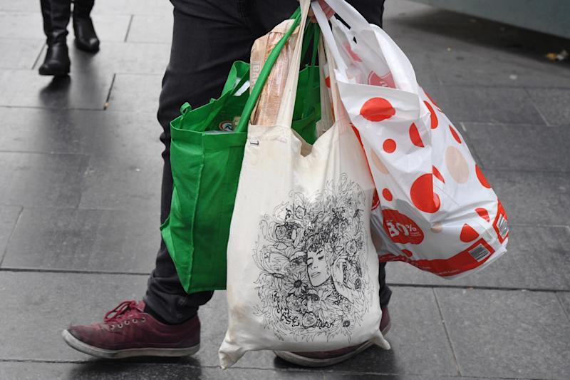 There are new rules being rolled out determining what level of contact supermarket workers can have with shoppers grocery bags. Source: AAP