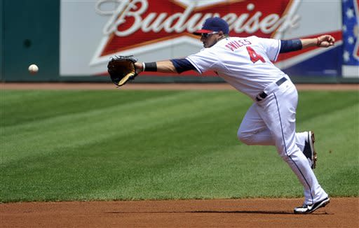 Cleveland Indians shortstop Mike Aviles cannot get to a hit by Minnesota Twins' Ryan Doumit during the first inning of a baseball game in Cleveland, Sunday, June 23, 2013. AP Photo/Phil Long)