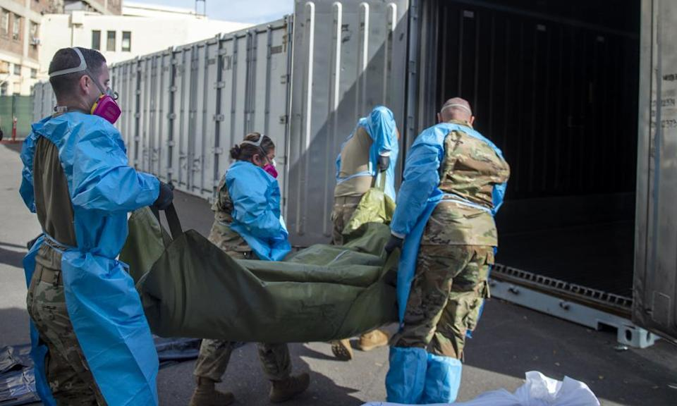 National guard members place the bodies of Covid victims into temporary storage at the medical examiner-coroner's office in Los Angeles.