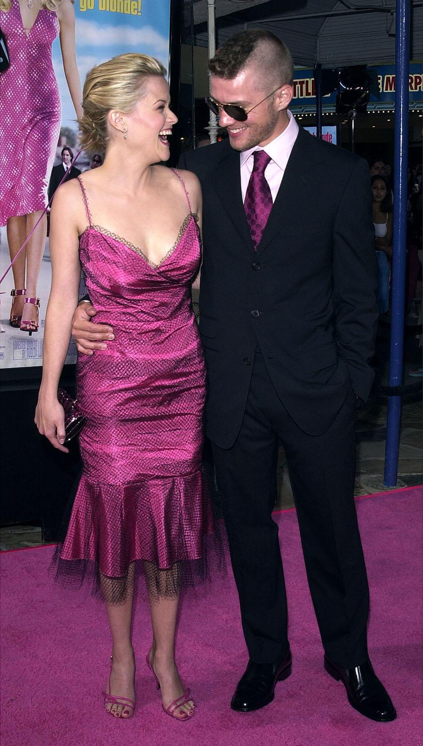"<p>In matching hues of Elle Woods pink, Reese and Ryan walked the pink carpet at the Los Angeles premiere. The role launched Reese onto the A List, and her character has become something of a feminist icon. Reese told <a href=""https://www.instagram.com/p/BHzk_HCj7Nx/?hl=en"" rel=""nofollow noopener"" target=""_blank"" data-ylk=""slk:Instagram"" class=""link rapid-noclick-resp"">Instagram</a> for the 15th anniversary, ""It actually had a meaningful story. And it was about female empowerment. It wasn't necessarily about the girl getting the guy.""<br> (Photo: Getty Images) </p>"