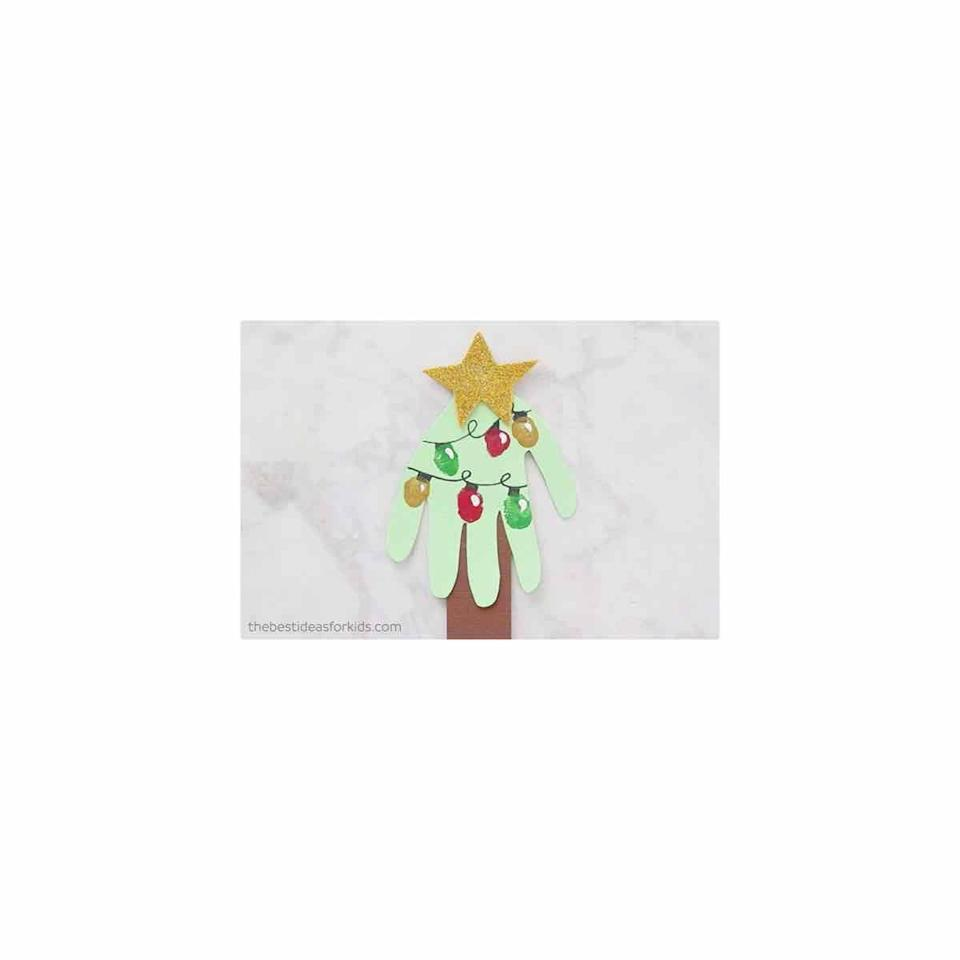 """<p>Who would ever guess that your child's handprint makes the perfect evergreen. To """"decorate"""" the tree, let them have a little fun with finger paints. </p><p><em>Get the tutorial at <a href=""""https://www.thebestideasforkids.com/handprint-christmas-card/"""" rel=""""nofollow noopener"""" target=""""_blank"""" data-ylk=""""slk:The Best Ideas for Kids"""" class=""""link rapid-noclick-resp"""">The Best Ideas for Kids</a>.</em></p><p><a class=""""link rapid-noclick-resp"""" href=""""https://www.amazon.com/Crayola-Washable-FingerPaints-Stocking-Stuffers/dp/B00MC7WV6K?tag=syn-yahoo-20&ascsubtag=%5Bartid%7C10072.g.34351112%5Bsrc%7Cyahoo-us"""" rel=""""nofollow noopener"""" target=""""_blank"""" data-ylk=""""slk:SHOP FINGER PAINT"""">SHOP FINGER PAINT</a></p>"""