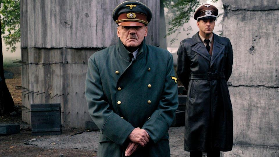 <p> Humanising Hitler (while far from excusing him) makes his crimes all the greater. Downfall takes a fly-on-the-wall approach to the Fuhrer's final ten days, told through the point-of-view of his secretary. In fact, it's the real-life Traudi Junge whose voice is heard opening the movie. Much was made of how the film paints a realistic portrait of a monstrous man, who displayed kindness to his staff while seconds later utter contempt for millions he sent to their deaths. It's a near-perfect piece of filmmaking, thanks to Bruno Ganz eerily-precise depiction of Hitler. </p>