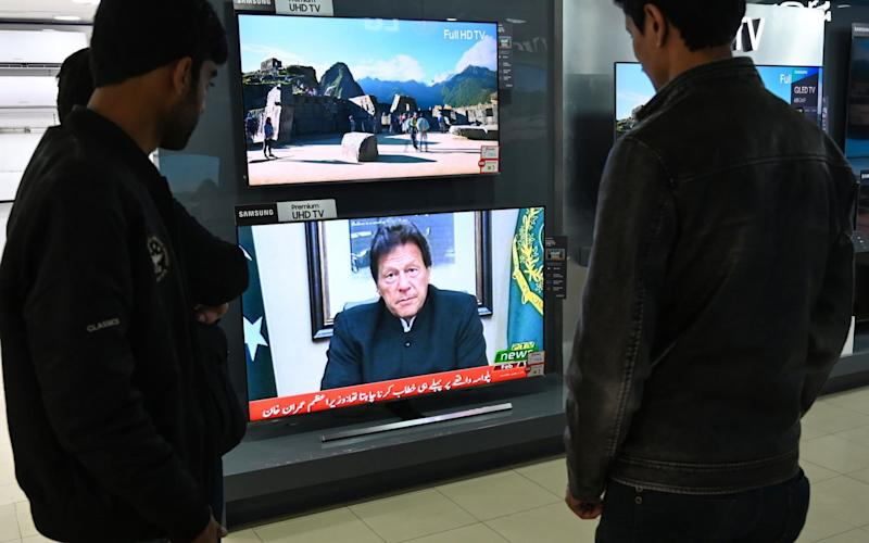 Imran Khan used a national television address to warn India that Pakistan would retaliate against aggression - AFP