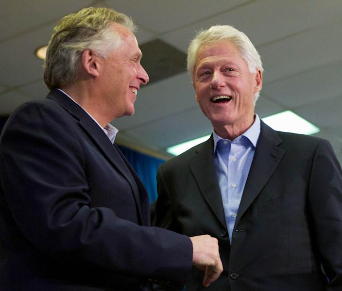 """Former President Bill Clinton campaigns for Democratic gubernatorial candidate for Virginia, Terry McAuliffe, at a """"Putting Jobs First"""" event in Dale City, Va., Sunday, Oct. 27, 2013. (AP Photo/Molly Riley)"""