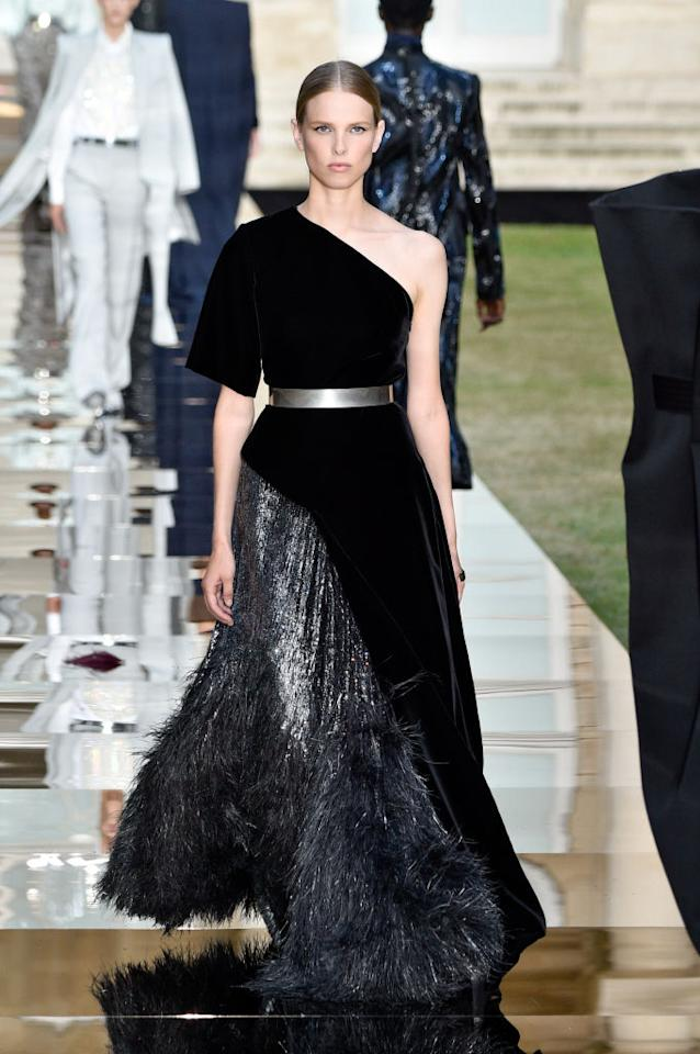 <p>Model wears a black velvet one-shoulder and metallic contrast gown from the Givenchy fall 2018 couture collection. (Photo: Getty Images) </p>