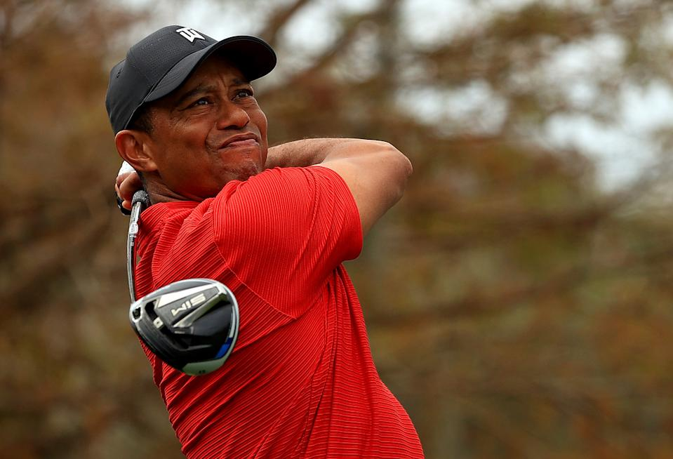 Tiger Woods remains sidelined following a February wreck. (Photo by Mike Ehrmann/Getty Images)