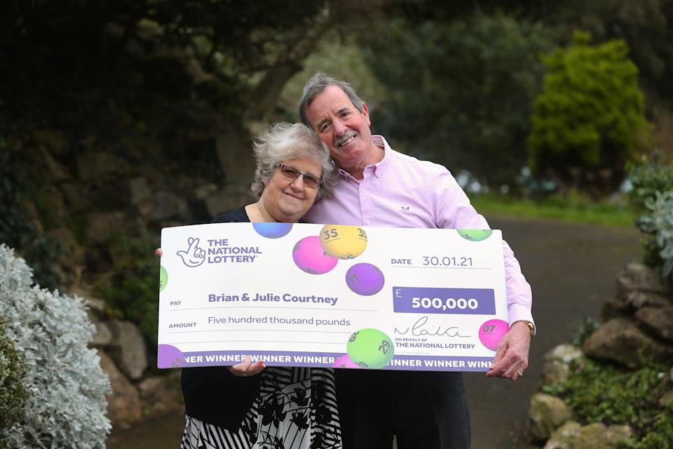 National Lottery Winners Brian and Julie Courtney of Weston Super Mare, Somerset, UK celebrate their £500,000 win