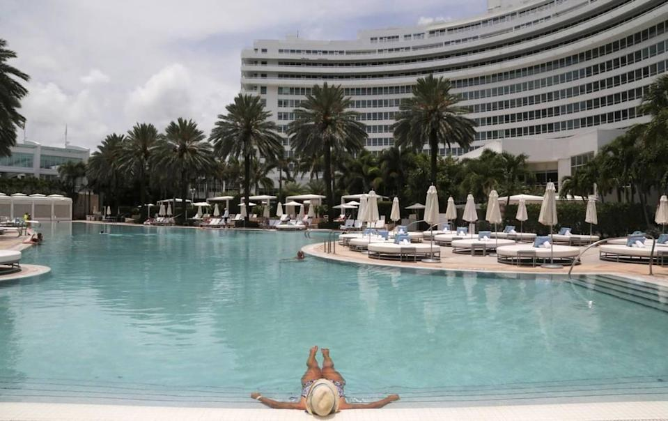 A hotel guest enjoys having the pool practically to herself at the Fontainebleau Miami Beach. The hotel reopened on June 1, 2020, after having to shut down due to the coronavirus pandemic.