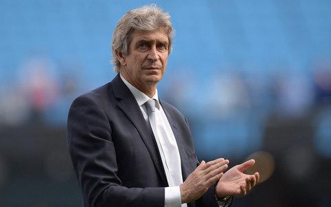 Manchester City's Chilean manager Manuel Pellegrini applauding the fans after the English Premier League football match between Manchester City and Arsenal at the Etihad Stadium - Credit: AFP/Getty Images