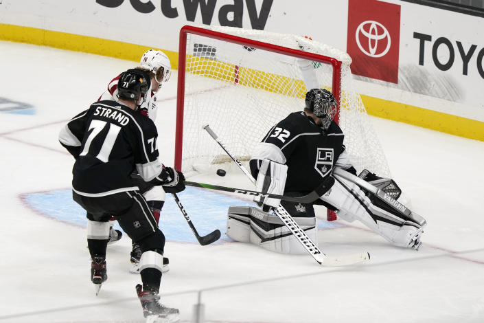 Los Angeles Kings goaltender Jonathan Quick (32) gives up a goal on a shot from Arizona Coyotes' Ilya Lyubushkin, not seen, during the first period of an NHL hockey game Wednesday, April 7, 2021, in Los Angeles. (AP Photo/Marcio Jose Sanchez)